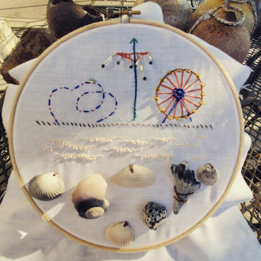 Embroidery in hoop inspired by Galveston beach and pier.